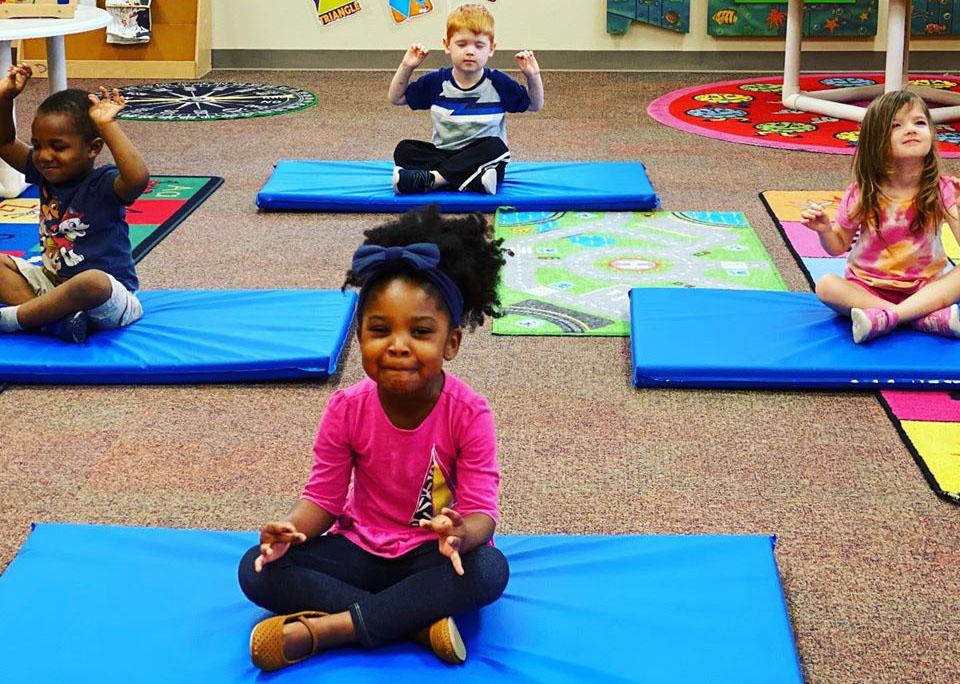 kids doing yoga at a Preschool & Daycare Serving Houston & Cypress, TX