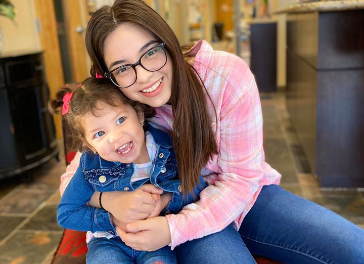 smiling teacher and little girl at a Preschool & Daycare Serving Houston & Cypress, TX